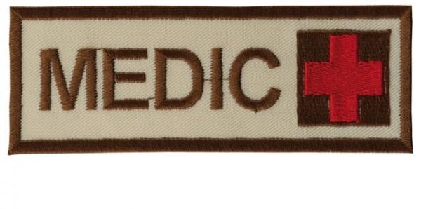 Schriftzug Medic mit Kreuz Sand/Braun/Rot